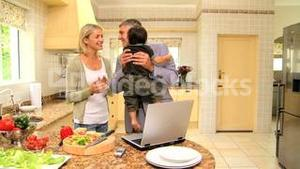 Man coming home from work and hugging his family