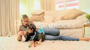 Toddler on carpet bored with building blocks