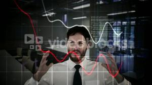 Stressed businessman with hands on head and digital graphic