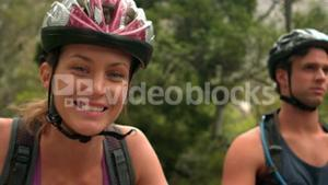 Couple biking through a forest