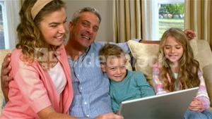 Smiling family using technology
