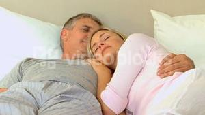 Relaxed couple sleeping