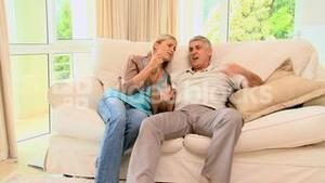 Couple looking at sports on tv