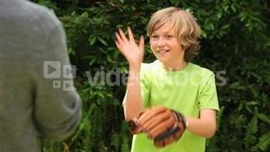 Blonde boy playing baseball