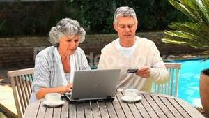 Mature couple buying something on internet