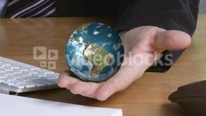 Businessman with a globe in his hand