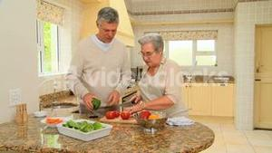Mature couple people cooking together
