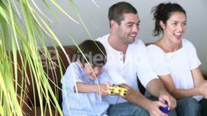 Happy family playing a video game 2