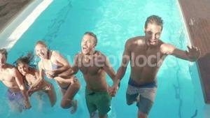 Happy friends diving into the pool