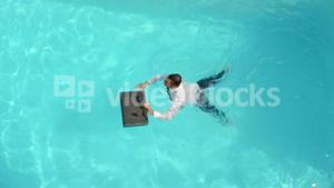 Businessman swimming in the pool