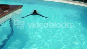 Man swimming in the pool