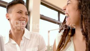 Happy lesbian couple laughing