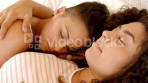 Peaceful lesbian couple sleeping