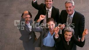 Happy business team raising fists