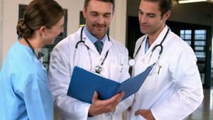 Doctors looking documents and talking
