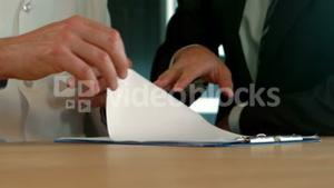 Businessman and doctor signing a agreement
