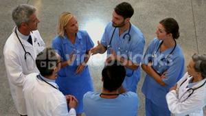 Group of doctors speaking together