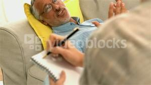 Worried patient talking with female doctor