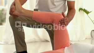 Pregnant woman exercising with physiotherapist