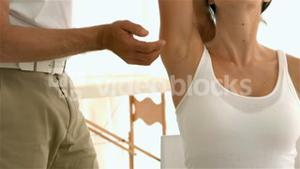 Therapist holding his patients arm