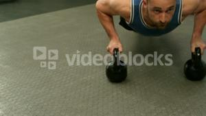 Fit man exercising with kettlebell