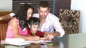 Parents helping their son with homework