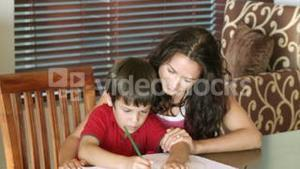 Mother with her son drawing
