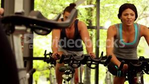 Fitness group working out on exercise bike