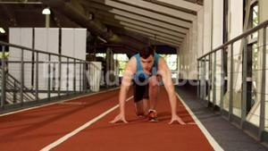 Young man ready to race on running track