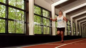 Fit man running on the indoor track