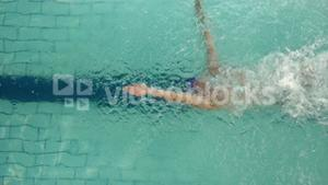 Above view of swimmer diving into pool