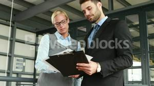 Business colleagues looking at documents
