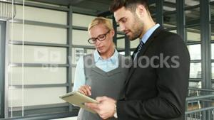 Business colleagues using tablet