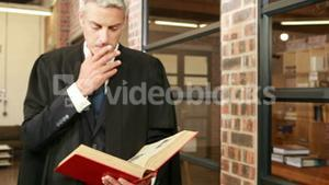 Mature magistrate reading book