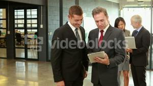Business people using tablet and laptop