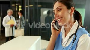 Smiling doctor on phone call