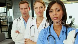 Portrait of standing doctors with arms crossed