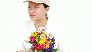 Happy flower delivery woman looking for signature