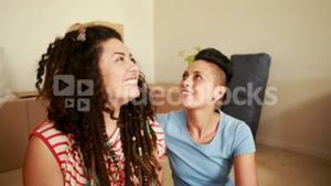 Smiling lesbian couple showing new keys