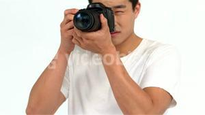 Asian man taking picture with professional camera
