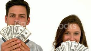 Happy couple holding money