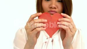 Sad woman halving heart shape