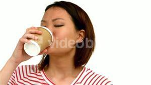 Smiling Asian woman drinking by disposable cup
