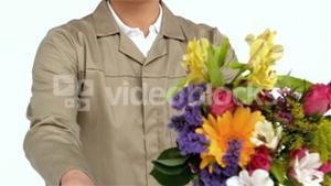 Postman holding flowers and handing document