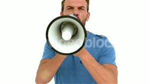 Angry man shouting with megaphone