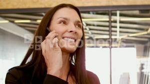 Smiling businesswoman on phone