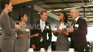 Smiling business people drinking coffee