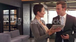 Business people with tablet working together