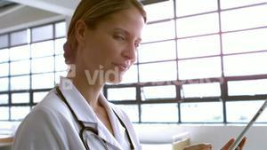 Smiling female doctor using tablet