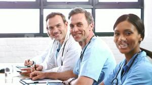 Smiling medical team in a meeting